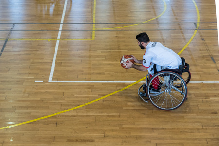 Unidentified people playing a friendly game of wheelchair basketball at a basketball Show.TURKEY, ISTANBUL,21 JANUARY 2017