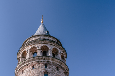 View of Galata Tower(Turkish: Galata Kulesi) called Christ Tower by Genoese a famous medieval landmark architecture in Istanbul, Turkey,February 18,2017.Copy space for editing.