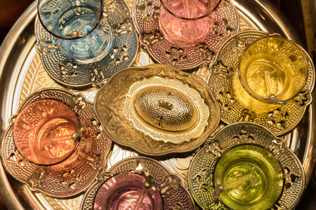 Top view of Traditional Turkish handmade silver or copper tea sets for sale at the Egyptian and Grand Bazaar in Istanbul, Turkey