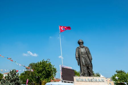 Statue of Ottoman Architecture Mimar Sinan(Architect Sinan) and Turkish flag on the background.TURKEY, ISTANBUL,30 JULY 2017