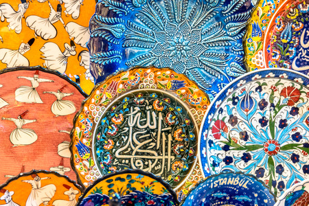 Collection of Traditional Turkish ceramics on sale at Grand Bazaar in Istanbul, Turkey. Colorful ceramic souvenirs.