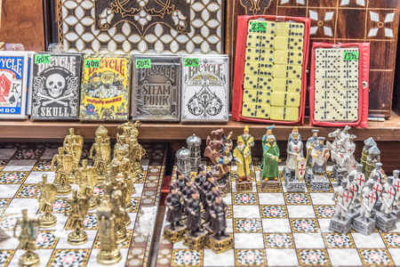 Decorative hand made brass,metal chess with the colorful painted chessmen, decorated with islamic,christian patterns in grand bazaar istanbul,Turkey Stock Photo