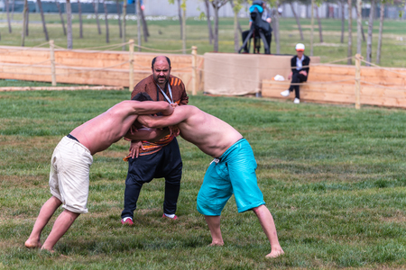 Unidentified people perform shalwar(shalvar or salvar) guresi,(kuroshiowrestling). Salvar wrestling is a kind of traditional Turkish wrestling. ISTANBUL,TURKEY,May 13,2017