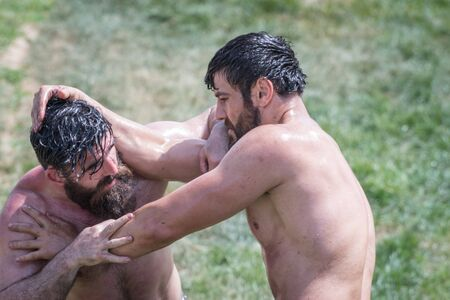 Unidentified Turkish people perform oil wrestling.Oil wrestling or grease wrestling (Yagli Gures) is Turkish national sport.ISTANBUL,TURKEY,May 13,2017 Editorial