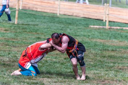 Unidentified people perform aba guresi (kuroshiowrestlers)at a public event.Aba wrestling is a traditional Turkish wrestling also called Asirtmali Aba Wrestling. ISTANBUL,TURKEY,May 13,2017 Editorial