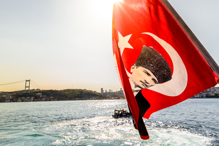 View of Bosphorus ,coast and sea bay from the ferry with Turkish flag on the picture of Ataturk(Father of Turks)waving in the wind, Beykoz in Istanbul, Turkey.