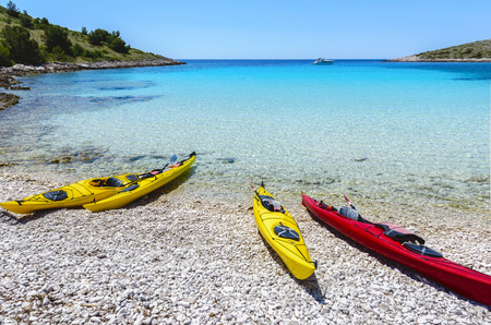 Canoe Boats on a bay of Kornati islands, National park in Croatia. Stock Photo