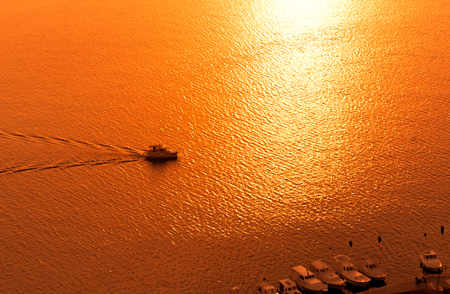 Sunset over the sea with sailing silhouette of boat or ship  on Sibenik coast ,Croatia