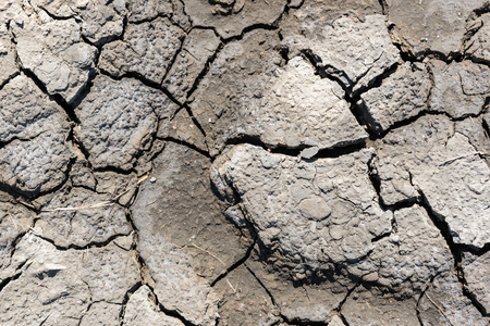 Top view of drought cracked soil texture.Dry mud background texture. Global Warming 스톡 콘텐츠