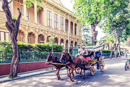 """Coach or Horse carriage with tourists at Buyukada (meaning """"Big Island"""" in English) or Prince Island.Buyuk ada is famous for beautiful streets and phaeton tour in Istanbul,Turkey.20 May 2017 Editorial"""
