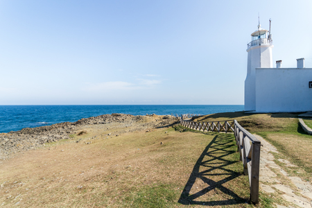 Landscape view of old white Inceburun lighthouse with blue sky on the north coast of Sinop,Turkey. Stok Fotoğraf