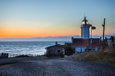 Sunset view of old white Inceburun lighthouse on the north coast of Sinop,Turkey.