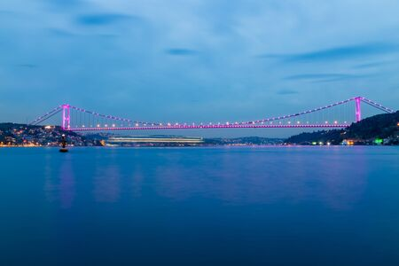Long exposure shot of Fatih Sultan Mehmet Bridge(FSM) with light trails after sunset over bosphorus in Istanbul,Turkey.02 May 2015