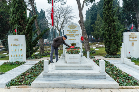 Unidentified man put flowers to Tomb of Mehmet Akif Ersoy,poet and author of Turkish National Anthem at Edirnekapi Martyrs Cemetery in Eyup district of Istanbul Province, Turkey.22 January 2017