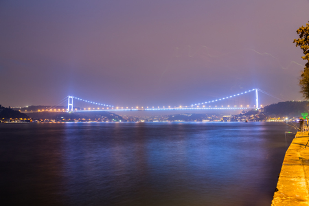 Long exposure shot of Fatih Sultan Mehmet Bridge(FSM) with light trails after sunset over bosphorus in Istanbul,Turkey.