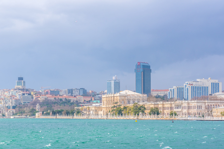 View of Dolmabahce Palace and Besiktas district from ferry in Istanbul, Turkey