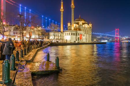 Exterior view of Ortakoy Mosque with15 July Martyrs Bridge or unofficially Bosphorus Bridge also called First Bridge over bosphorus in Istanbul,Turkey.03 January 2018 Editorial