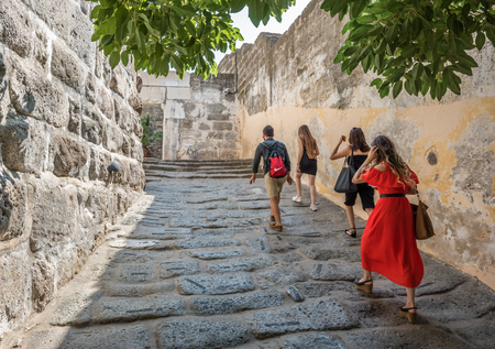 Unidentified people walk and explore in Castle of St. Peter or Bodrum Castle, Turkey.23 August 2017