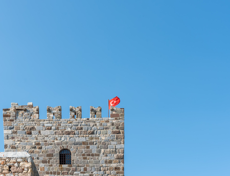 Detailed view of stone tower in Castle of St. Peter or Bodrum Castle,Turkish flag on top in Bodrum,Turkey  Reklamní fotografie