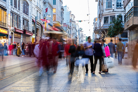 Long exposure or slow shutter speed and blurred image:Unidentified people walk at Istiklal street,popular destination in Istanbul,Turkey.29 April 2018