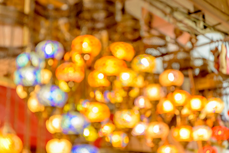 Blurred Traditional colorful handmade Turkish lamps and lanterns hanging in souvenir shop for sale
