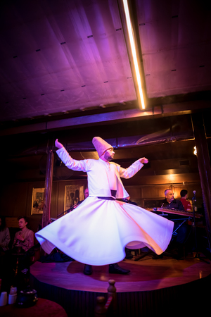 05 May 2018 :- Unidentified Turkish dervish man performs Mevlevi,Sama Ceremony for a show at cafe in Istanbul,Turkey.