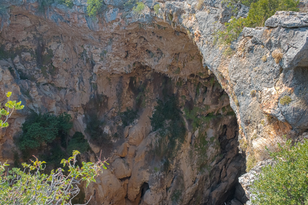 Aerial interior view of the pit of hell(cehennnem) located in Silifke district, Mersin Turkey.