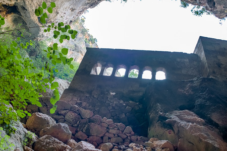 View of Virgin Mary Church built by St. Paulus from inside of cave of Chasm of Heaven in Silifke district.Mersin Turkey Фото со стока