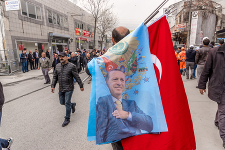AKP (Justice and Development Party) supporters shout slogans and wave party flags during a yes referendum,plebiscite campaign rally in Istanbul, Yenikapi meeting area.TURKEY, ISTANBUL, APRIL 8, 2017