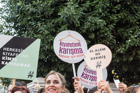 Women Protesters rally in kadikoy against interfering women clothes. Women carry