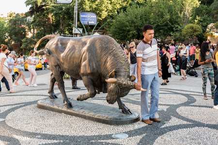 Bull statue at the Kadikoy square is symbol of Kadikoy and a popular meeting point. TURKEY, ISTANBUL,29 JULY 2017 Publikacyjne