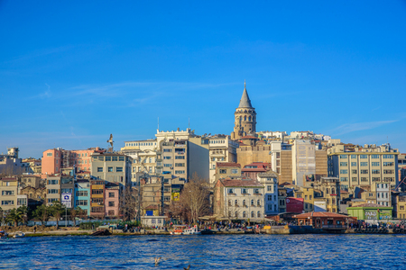 ISTANBUL, TURKEY - MARCH 5, 2017:Galata Tower, Galata Bridge, Karakoy district and Golden Horn in the early morning light, Istanbul, Turkey