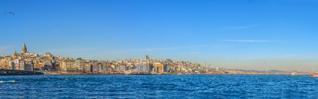 ?STANBUL, TURKEY - MARCH 5, 2017:Panoramic view of famous Galata tower with Bosphorus and Galata bridge on a sunny day