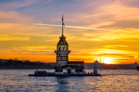 TURKEY -ISTANBUL:5 MARCH 2017 ,Maiden Tower,medieval building/lighthouse,(Tower of Leandros,Turkish: Kiz Kulesi) at entrance to Bosporus Strait with Hagia Sophia and Blue Mosque in far distance