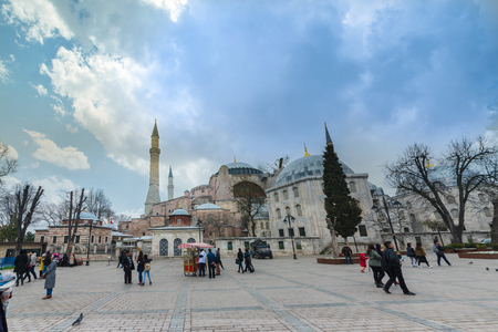 Unidentified people visit Hagia Sophia,a Greek Orthodox Christian patriarchal basilica (church),built in 537 AD, later an imperial mosque, and now a museum.ISTANBUL, TURKEY- MARCH 11,2017