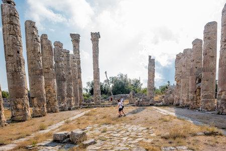 Unidentified tourists walking and exploring Zeus temple at Uzuncaburc Ancient city located in Uzuncaburc,Silifke,Mersin,Turkey.29 August 2017