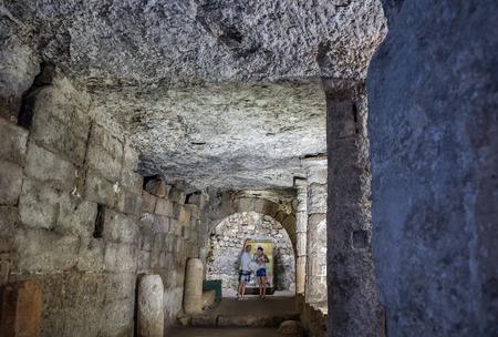 People visit Aya Tekla underground cave Church also known as Saint Aya Thecla ,Aya Thekla, is ruined historic church of Byzantine.Silifke,Mersin,Turkey.29 August 2017.