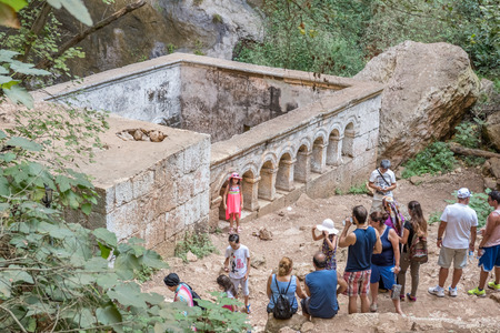 Unidentified people going down to stone stairs towards cave of Chasm of Heaven in Silifke district.St. Paulus Chapel is in the background.Mersin Turkey.29 August 2017. Editorial