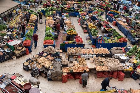 Top view of popular Melike Hatun Bazaar or kadinlar pazari(Women Bazaar) that is a traditional Turkish grocery bazaar where people buy Vegetables, fruits and spices in Konya,Turkey.28 August 2017 Editöryel