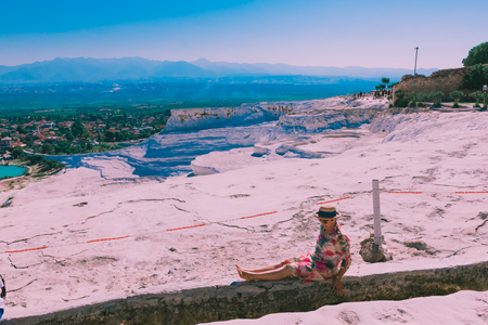 Unidentified people visit Pamukkale (Cotton Castle) that is popular with Travertine pools and terraces  where people love to visit in Pamukkale, Turkey.25 August,2017