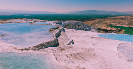 Turquoise color view of Pamukkale (Cotton Castle) is popular with Travertine pools and terraces  where people love to visit in Pamukkale, Turkey. Banco de Imagens