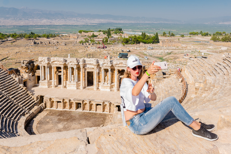 Unidentified girl take selfie at The ruins of Antique Theater in ancient Greek city Hierapolis, Pamukkale, Turkey.25 August,2017 Sajtókép