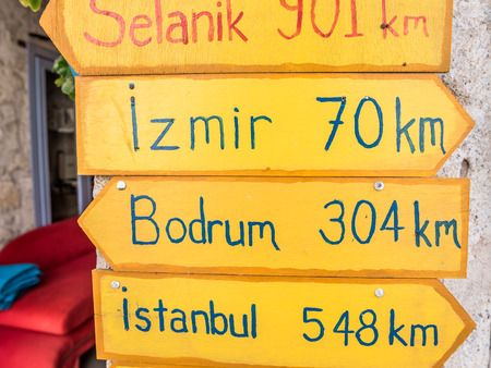 A wooden orange sign post showing distances, in Kilometers, to some of the major cities in Turkey. Stock fotó