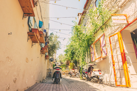 Street view of Alacati district of Cesme.A motorcycle on the foreground.Alacati  is a popular destination for traveling and vacation in Izmir,Turkey.26 August 2017.