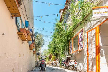 HDR image-Street view of Alacati district of Cesme.A motorcycle on the foreground.Alacati  is a popular destination for traveling and vacation in Izmir,Turkey.26 August 2017.