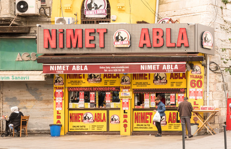 Shop of Nimet Abla(Blessing Sister) is a famous lottery ticket seller,dealer at Eminonu district.Nimet in Istanbul,Turkey,28 October 2017