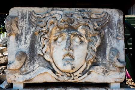 Stone carved Medusa head at Apollo Temple at Didyma in Didim,Aydin,Turkey Stock Photo