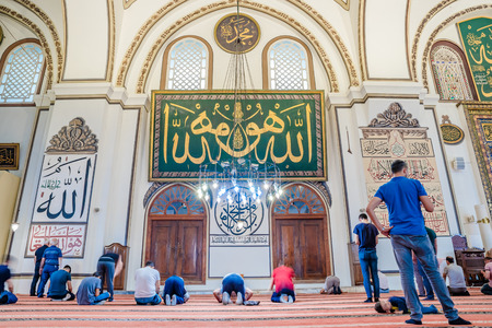 Unidentified people pray or walk to explore in Grand Mosque or Ulu Cami is largest mosque in Bursa,Turkey.20 May 2018