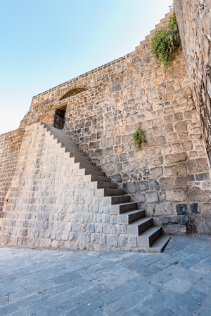 Ancient walls of Historical gate named as Mardin gate in sur region in central of Diyarbakir,Turkey.