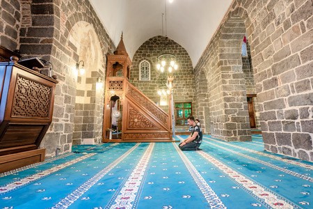Unidentified Muslim man pray at Hazreti Suleyman Mosque in Sur region,Diyarbakir,Turkey.15 July 2018